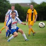 Jack Kelly clears for Rathangan against Naas United in the Hill Electrical Division 3 game at Monread Park