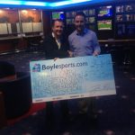 Niall Carew collecting his cheque for €170,322 euro from Boylesports after landing a massive gamble thanks to a draw between Kerry and Mayo in the All-Ireland football semi-final