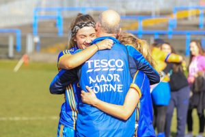 Emma Wheeler celebrates with her coach, and father, Eoin Wheeler