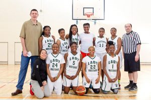 The Harry S. Truman high school basketball team along with their coach, Naas native John Burke. The girls recently visited their coach's home town.