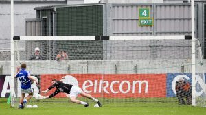 Mark Donnellan dives to his right to keep out Ross Munnelly's penalty  Photo: ©INPHO/Ken Sutton