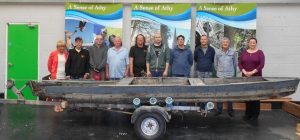 Members of  Athy Mens Shed pictured with an original Barrow Cot Boat which was used by Cassidy's Bewery in Monasterevin before it closed in the 1920s: Raphael Clarke, Kevin Vernal, Dave Kenny, Ricky Kay, Atilla Nagy, Derek Samblin, Chris Lalor and Eddie Kilpatrick with Patricia Berry (left) and Helen Dowling (rght) of the Athy Enterprise Centre