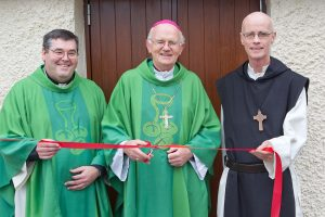 Fr Frank McEvoy, Bishop Eamonn Walsh and Dom. Michael Ryan officially cut the ribbon marking the end of renovation works in Moone Parish Hall