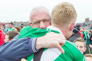 Sarsfields manager John Crofton is overcome with emotion as he embraces man of the match Ray Cahill Photo: Piotr Kwasnik